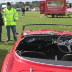 Our club cars in show arena - Is that Mr or Mrs Healey?
