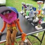 Club mascot protecting the trophies