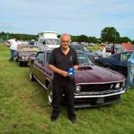 Steve Byng Best American Car on a club stand
